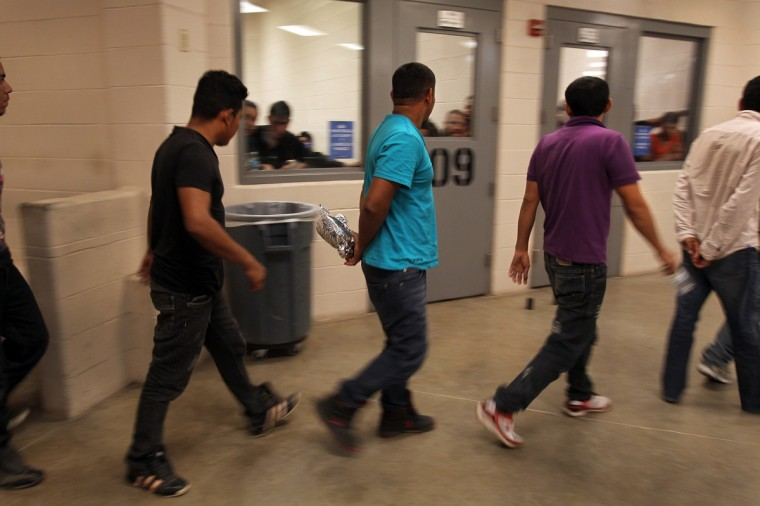 Inside the McAllen Border Patrol Station in McAllen, Texas July 15, 2014. Detainees are both men and women, and range in age from infants to adults, where more than 350 were being held. (Rick Loomis//Reuters/Getty)