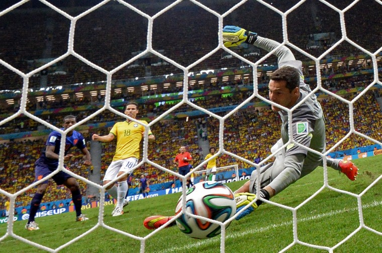 Brazil's goalkeeper Julio Cesar (R) fails to save Netherlands' midfielder Georginio Wijnaldum's (L) goal during the third place play-off football match between Brazil and Netherlands during the 2014 FIFA World Cup at the National Stadium in Brasilia. (Damien Meyer/AFP-Getty Images)