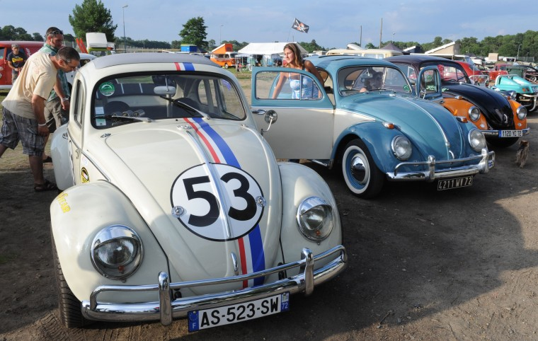 "People look at Volkswagen Beetles displayed during the ""Super VW Festival"" on Le Mans' circuit, western France. The festival, which runs from July 25 to 27, gathers nearly 1200 aircooled Volkswagen cars including the models Beetle, Transporter, and Dune Buggy. (Jean-Francois Monier/AFP-Getty Images)"