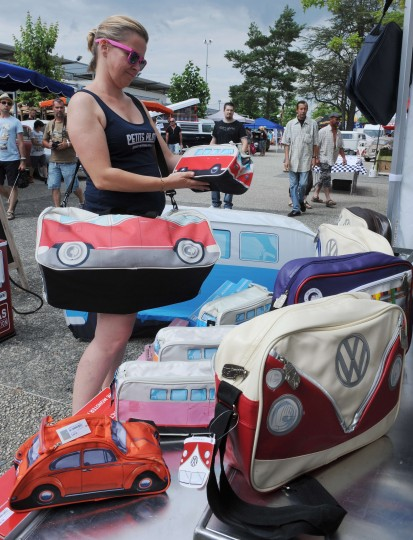 "A woman looks at Volkswagen bags during the ""Super VW Festival"" on Le Mans' circuit, western France. The festival, which runs from July 25 to 27, gathers nearly 1200 aircooled Volkswagen cars including the models Beetle, Transporter, and Dune Buggy. (Jean-Francois Monier/AFP-Getty Images)"