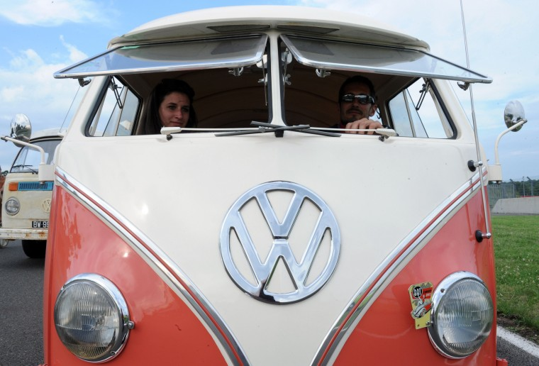 "French collector Sylvain Perdoux sits in his Volkswagen Transporter during a Volkswagen parade during the ""Super VW Festival"" on Le Mans' circuit, western France. The festival, which runs from July 25 to 27, gathers nearly 1200 aircooled Volkswagen cars including the models Beetle, Transporter, and Dune Buggy. (Jean-Francois Monier/AFP-Getty Images)"
