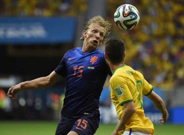 Netherlands' defender Dirk Kuyt (L) and Brazil's midfielder Oscar vie during the third place play-off football match between Brazil and Netherlands during the 2014 FIFA World Cup at the National Stadium in Brasilia . (Odd Andersen/AFP-Getty Images)
