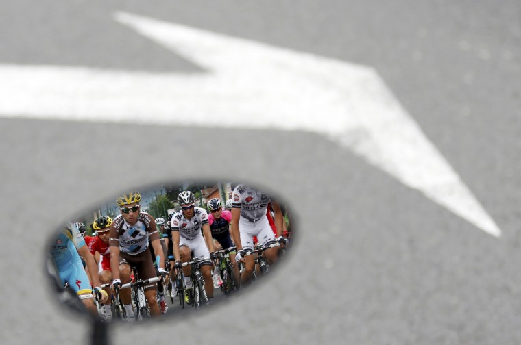 The pack of riders is reflected in a rear mirror during the 177-km fourteenth stage of the Tour de France cycling race between Grenoble and Risoul. (Jean-Paul Pelissier/Reuters)
