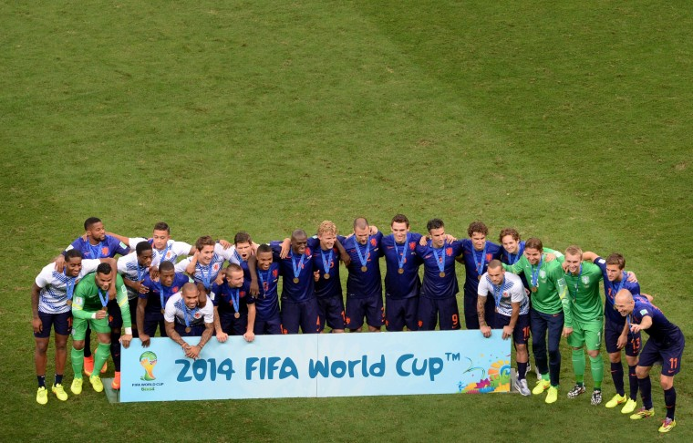 Netherlands' team pose for a group photo with their bronze medals after winning the third place play-off football match between Brazil and Netherlands 3-0 during the 2014 FIFA World Cup at the National Stadium in Brasilia. (Evaristo Sa/AFP-Getty Images)