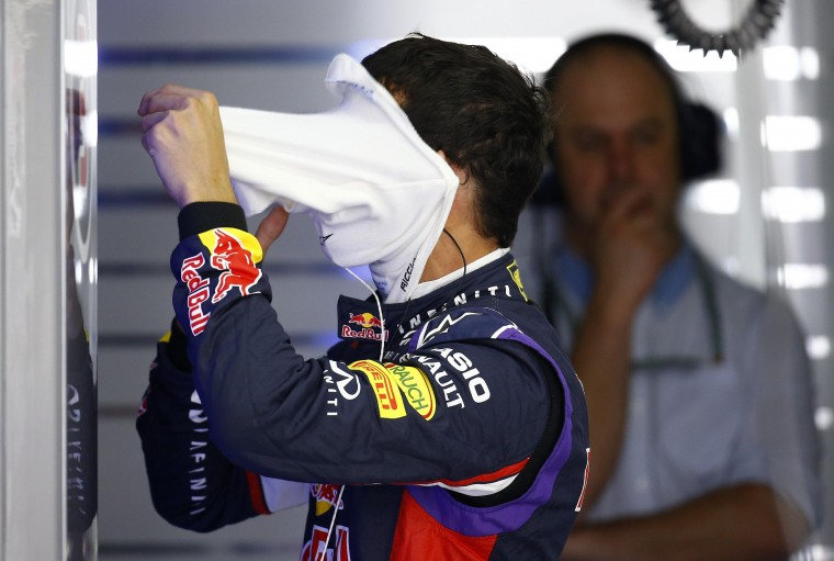 Red Bull Formula One driver Daniel Ricciardo from Australia takes off his face mask during the third free practice session ahead of the German F1 Grand Prix at the Hockenheim racing circuit. The German Grand Prix will take place on Sunday, July 20. (Kai Pfaffenbach/Reuters)