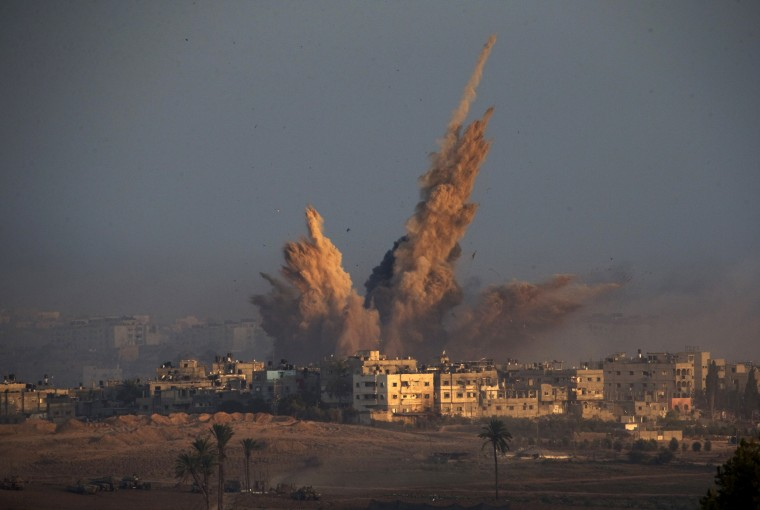 An explosion from an Israeli strike in the northern Gaza Strip is pictured from the Israeli border with Gaza, early morning before a cease-fire takes effect. A 12-hour humanitarian truce went into effect on Saturday after Israel and Palestinian militant groups in the Gaza Strip agreed to a U.N. request for a pause in fighting and efforts proceeded to secure a long-term cease-fire moved ahead. (Ronen Zvulun/Reuters))