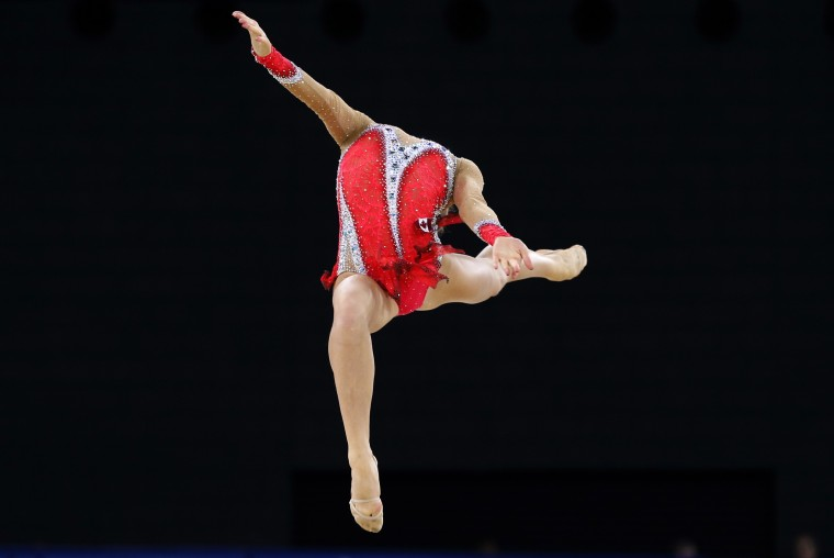 Patricia Bezzoubenko of Canada performs during her hoop routine as she competes in the rhythmic gymnastics individual apparatus final at the 2014 Commonwealth Games in Glasgow, Scotland. (Russell Cheyne/reuters)