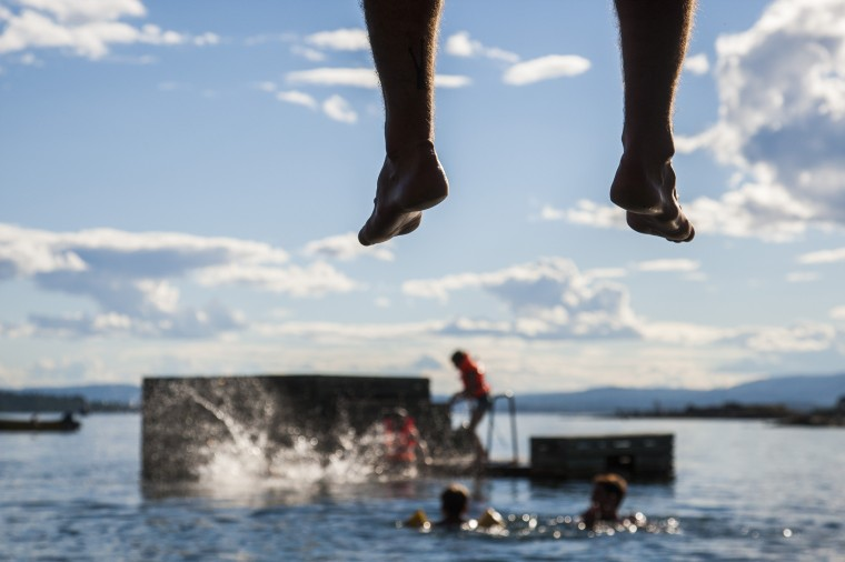 Parents watch from a boardwalk as children play and swim around a floating dock off the island of Lindoya in the Oslo fjord. The Norwegian capital has seen good summer weather with temperatures reaching 27 degrees celsius and the sea water up to 20 celsius the last few days. (Odd Andersen/AFP-Getty Images)