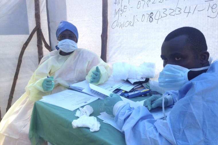 Government health workers are seen during the administration of blood tests for the Ebola virus in Kenema, Sierra Leone, June 25, 2014. (REUTERS/Umaru Fofana)
