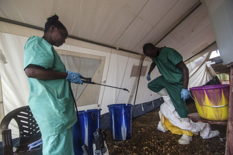 A health worker removes his protective suit as he emerges from an isolation area at the Medecins sans Frontieres Ebola treatment centre in Kailahun on July 20, 2014. Sierra Leone now has the highest number of Ebola cases, at 454, surpassing neighboring Guinea where the outbreak originated in February. (REUTERS/Tommy Trenchard)