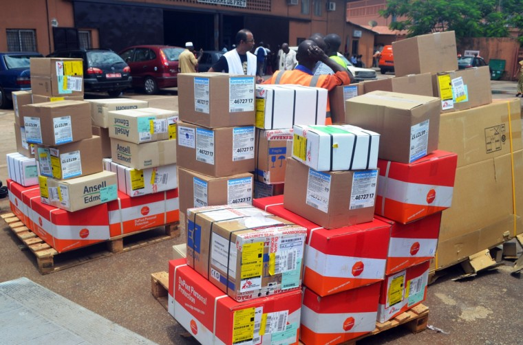 A member of Doctors Without Borders (MSF) wearing a white jersey (C) supervises the unloading of protection and healthcare material on July 22, 2014 at Conakry's airport, to fight the spread of the Ebola virus and treat people who have been already infected. The death toll in West Africa's Ebola outbreak has risen to 603, the World Health Organization (WHO) said last week, with 68 new fatalities mostly in Sierra Leone and Liberia. The UN health agency said the new deaths were recorded between July 8 and 12, and that 52 of them were in Sierra Leone, 13 in Liberia and three in Guinea, which had previously borne the brunt of the outbreak. Ebola first emerged in 1976 in what is now the Democratic Republic of Congo, and is named after a river in that country. (Cellou Bianani/AFP/Getty Images)
