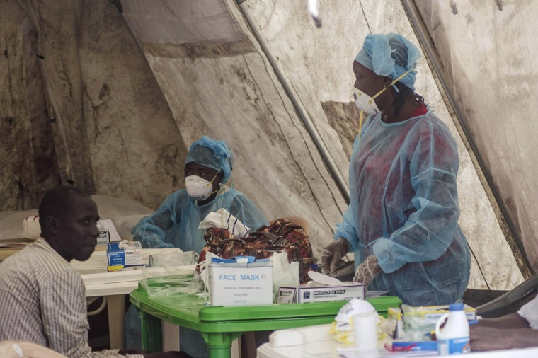 Health workers take blood samples for Ebola virus testing at a screening tent in the local government hospital in Kenema, Sierra Leone, June 30, 2014. The Ebola outbreak has killed 467 people in Guinea, Liberia and Sierra Leone since February, making it the largest and deadliest ever, according to the World Health Organization (WHO). West African states lack the resources to battle the world's worst outbreak of Ebola and deep cultural suspicions about the disease remain a big obstacle to halting its spread, ministers said on Wednesday. Picture taken June 30, 2014. (Tommy Trenchard/Reuters)