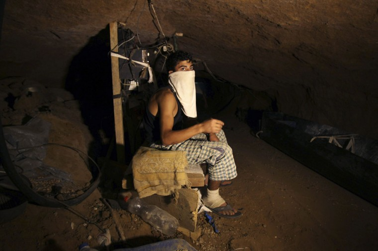 A Palestinian smuggler rests inside a tunnel beneath the Egyptian-Gaza border in Rafah, in the southern Gaza Strip on September 17, 2012. (REUTERS/Ibraheem Abu Mustafa)