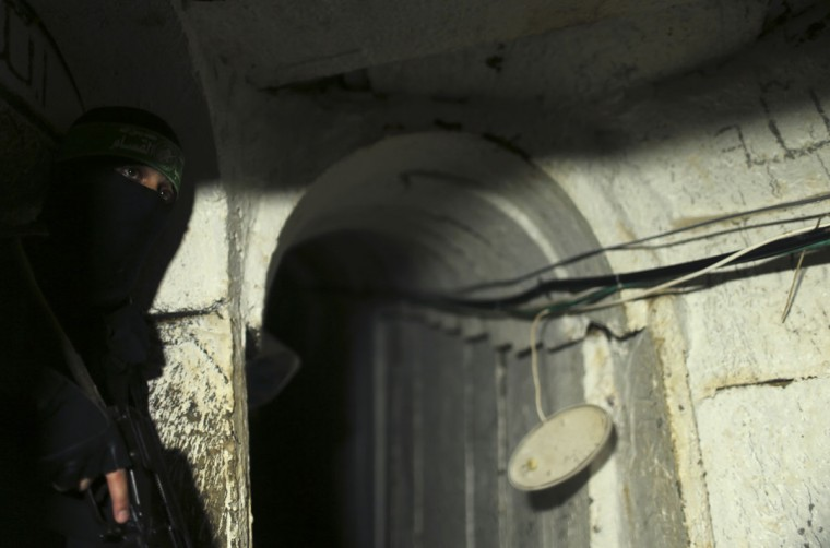 A Palestinian fighter from the Izz el-Deen al-Qassam Brigades, the armed wing of the Hamas movement, is seen inside an underground tunnel in Gaza on August 18, 2014. (REUTERS/Mohammed Salem)