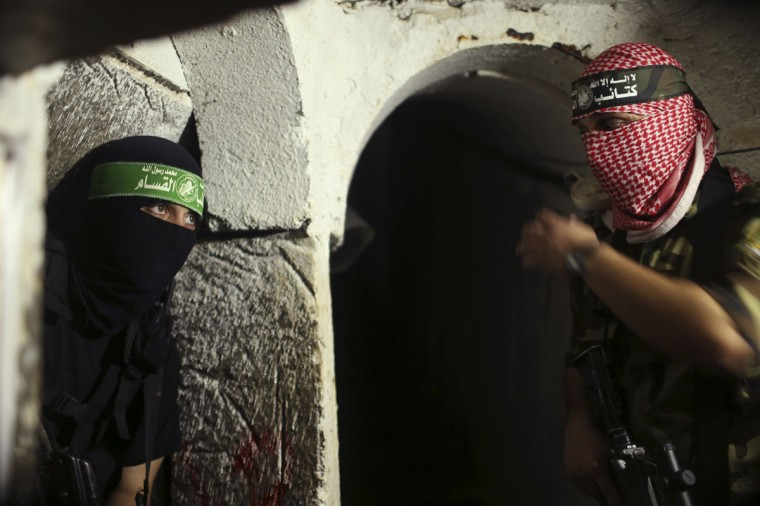 Palestinian fighters from the Izz el-Deen al-Qassam Brigades, the armed wing of the Hamas movement, are seen inside an underground tunnel in Gaza on August 18, 2014. (REUTERS/Mohammed Salem)