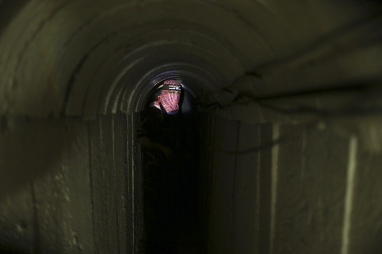 A Palestinian fighter from the Izz el-Deen al-Qassam Brigades, the armed wing of the Hamas movement, stands inside an underground tunnel in Gaza on August 18, 2014. (REUTERS/Mohammed Salem)