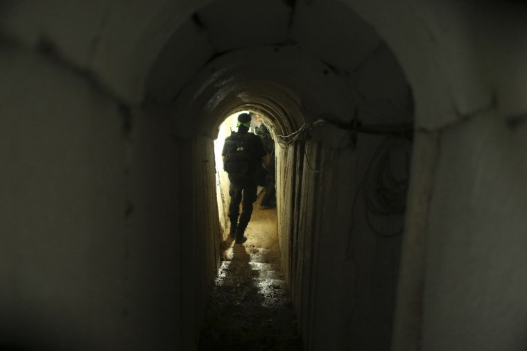A Palestinian fighter from the Izz el-Deen al-Qassam Brigades, the armed wing of the Hamas movement, walks inside an underground tunnel in Gaza on August 18, 2014. (REUTERS/Mohammed Salem)