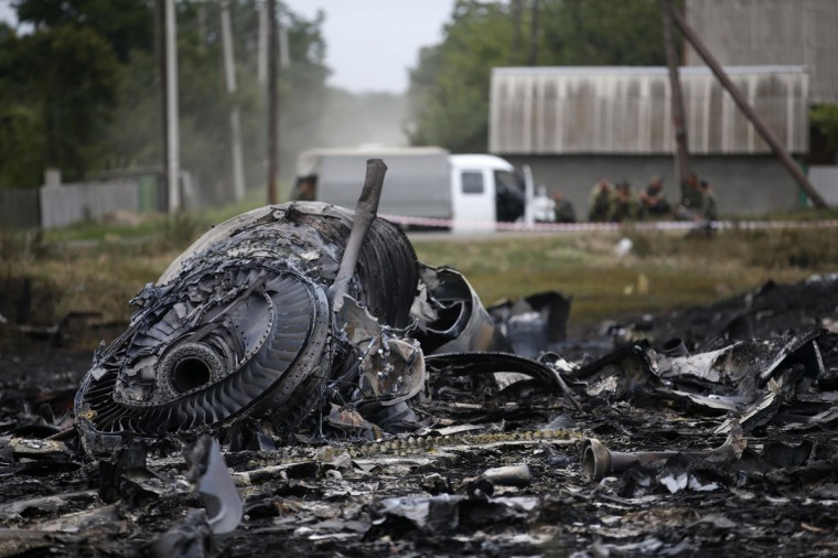 Debris is pictured at the site of Thursday's Malaysia Airlines Boeing 777 plane crash, near the village of Grabovo in the Donetsk region July 18, 2014. World leaders demanded an international investigation into the shooting down of Malaysia Airlines Flight MH17 with 298 people on board over eastern Ukraine, as Kiev and Moscow blamed each other for a tragedy that stoked tensions between Russia and the West. (Maxim Zmeyev/Reuters)