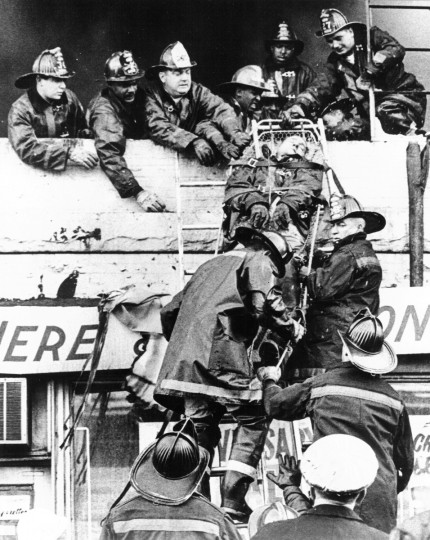 William LaForce took first place in the Spot News category for this photograph of firemen carefully lowering one of their co-workers who was overcome fighting a Baltimore fire in May of 1968. (William L. LaForce, Jr./Baltimore Sun)