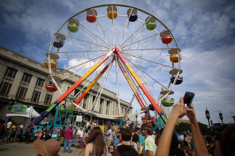 The ferris wheel stands on Charles Street near Penn Station during Artscape 2014. (Al Drago/Baltimore Sun)