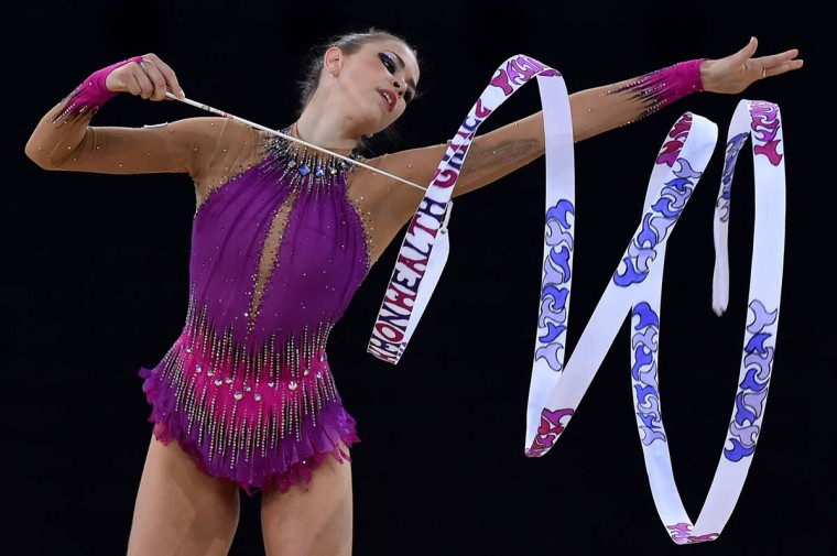 Wales's silver medalist Francesca Jones competes in the ribbon discipline, during the Individual All-Around Final of the Rhythmic Gymnastics event at The SSE Hydro venue at the 2014 Commonwealth Games in Glasgow July 25, 2014. (Ben Stansall/Getty Images)