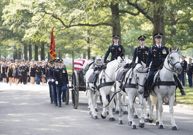A caisson from the Army's Old Guard carries the casket of US Army Major General Harold Greene, during funeral services at Arlington National Cemetery in Arlington, Virginia, on August 14, 2014. Major General Greene was shot dead on August 5, 2014 at a training center in Kabul in an attack that left more than a dozen others wounded, including a senior German officer. He was the highest ranking US Army officer killed in combat since the Vietnam War. (Saul Loeb/Getty Images)