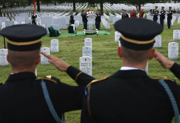 Members of the U.S. Army salute as the casket of U.S. Army Maj. Gen. Harold J. Greene is carried to the gravesite during a full honors funeral service at Arlington National Cemetery, August 14, 2014 in Washington, DC. Greene was shot and killed as he visited Afghanistan's national military academy in Kabul, Afghanistan. He is the highest ranking Army officer killed in combat since the Vietnam War. (Mark Wilson/Getty Images)