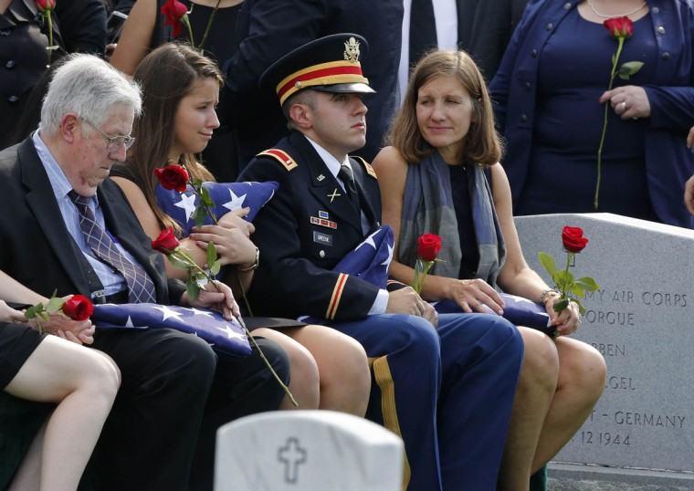 The immediate family of U.S. Army Maj. Gen. Harold J. Greene sits during a full military honors ceremony at Arlington National Cemetery in Virginia, August 14, 2014. Greene was killed in Afghanistan earlier this month and is the highest ranking U.S. military officer killed in combat since the Vietnam War. (From left to right) Seated are: Harold Greene, father, Amelia Greene, daughter, First Lt. Matthew Greene, son, and Susan Myers, wife. (Larry Downing/Reuters photo)
