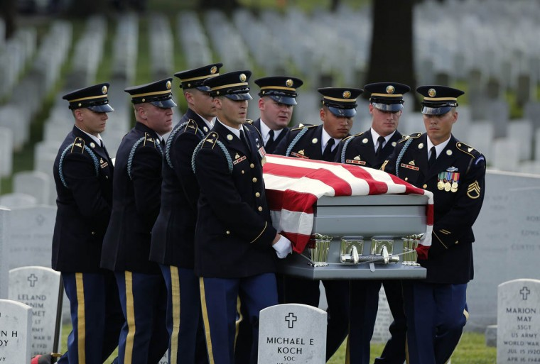 Military pallbearers carry the casket of U.S. Army Maj. Gen. Harold J. Greene during a full military honors burial ceremony at Arlington National Cemetery in Virginia, August 14, 2014. Greene was killed in Afghanistan earlier this month and is the highest ranking U.S. military officer killed in combat since the Vietnam War. (Larry Downing/Reuters photo)