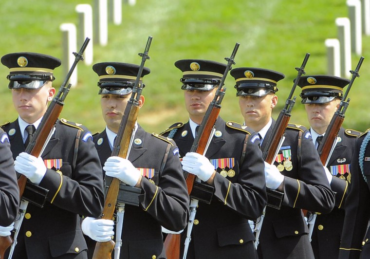 Members of the Army's Old Guard approaches the burial site of US Army Major General Harold Greene, during funeral services at Arlington National Cemetery in Arlington, Virginia, on August 14, 2014. (Al Drago/Baltimore Sun)