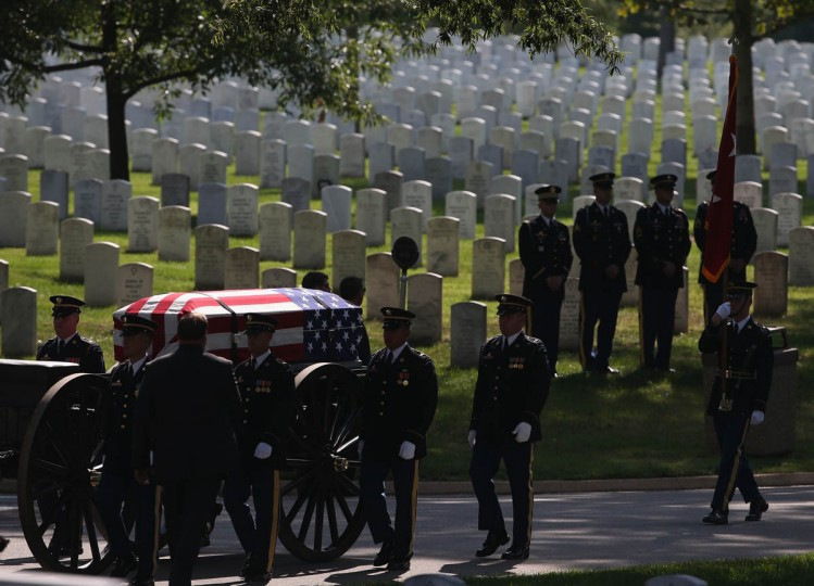 A spot of sunlight hits the casket of U.S. Army Maj. Gen. Harold J. Greene as it rides on a caisson during a full honors funeral service at Arlington National Cemetery, August 14, 2014 in Washington, DC. Greene was shot and killed as he visited Afghanistan's national military academy in Kabul, Afghanistan. He is the highest ranking Army officer killed in combat since the Vietnam War. (Mark Wilson/Getty Images)