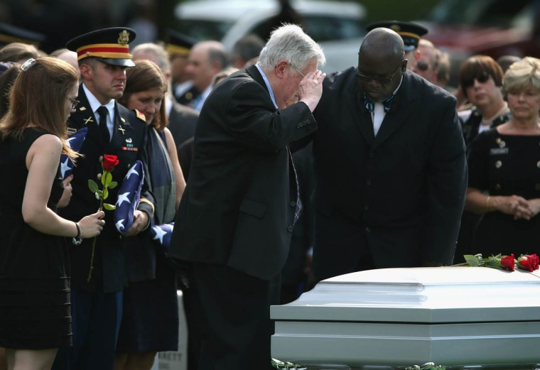 Harold Greene salutes over the casket of his son, U.S. Army Maj. Gen. Harold J. Greene during a full honors funeral service at Arlington National Cemetery, August 14, 2014 in Washington, DC. Greene was shot and killed as he visited Afghanistan's national military academy in Kabul, Afghanistan. He is the highest ranking Army officer killed in combat since the Vietnam War. (Mark Wilson/Getty Images)