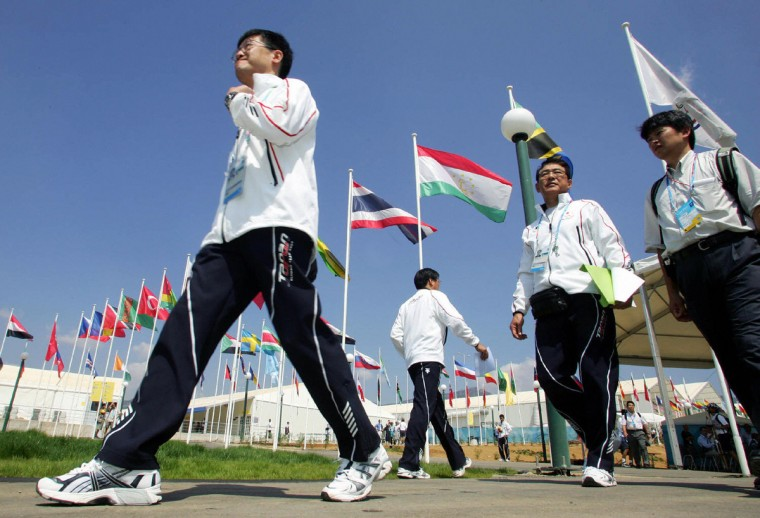 Unidentified members of the Japanese Olympic team walk 10 August 2004 inside the in Olympic Village in Athens, three days before the beginning of the 2004 Olympic Games. (Franck Fife/Getty Images)