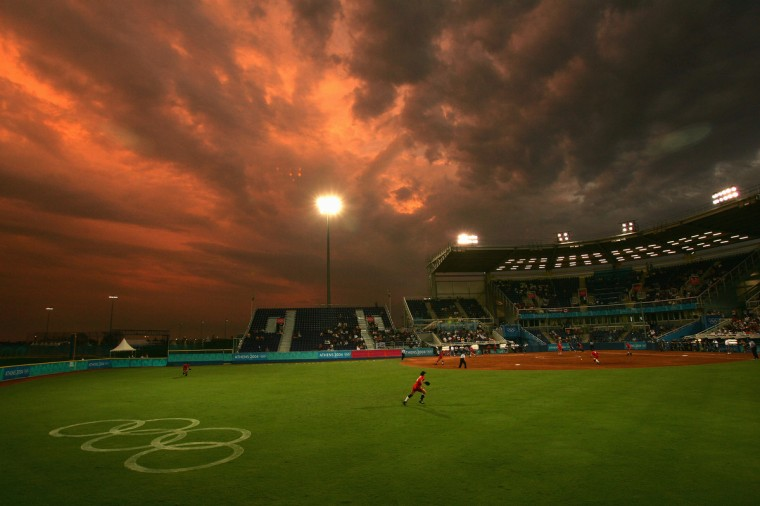 Rachel Schill #6 of Canada runs in to make a play during their game against Greece during the preliminary softball game on August 15, 2004 during the Athens 2004 Summer Olympic Games at the Softball Stadium in the Helliniko Olympic Complex in Athens, Greece. Greece won 2-0. (Ezra Shaw/Getty Images)