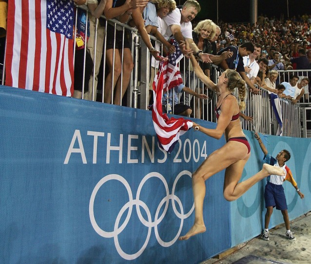 Kerri Walsh of United States celebrates defeating Adriana Behar and Bede Shelda of Australia in the women's gold medal Beach Volleyball match on August 24, 2004 during the Athens 2004 Summer Olympic Games at the Olympic Beach Volleyball Centre at the Faliro Coastal Zone Complex in Athens, Greece. USA won 21-17, 21-11. (Jonathan Ferrey/Getty Images)