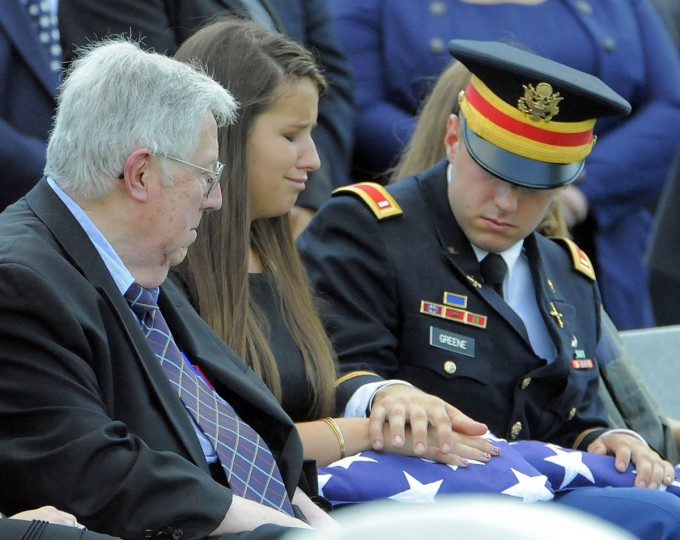 Amelia Greene, daughter of Major General Harold J. Greene of the U.S. Army, is consoled by her grandfather, Harold Greene, left, and her brother, 1st Lt. Matthew Greene, at the burial of her father at Arlington National Cemetery in Arlington, Va. on Thursday, August 14, 2014. (Al Drago/Baltimore Sun)