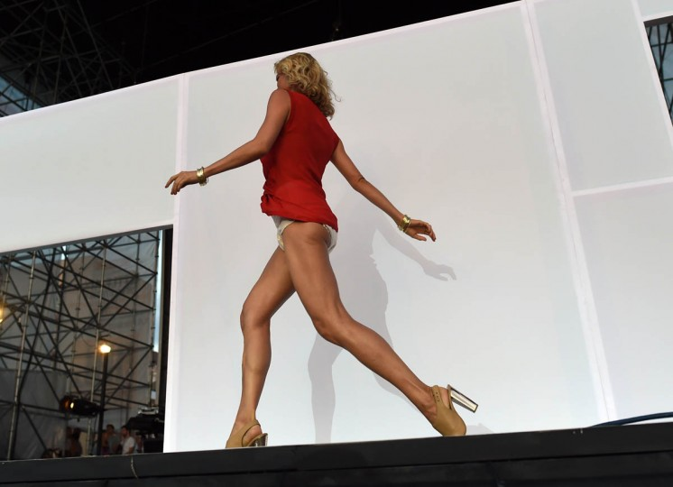 "A model arrives at Pier 97 in New York August 6, 2014 for the ""Drop Your Pants and Dance for Underwareness"" to help support the 65 million Americans who experience bladder leakage by bringing the condition and Depend Underwear out of hiding. For every pants drop, photo and video shared using #Underwareness and #DropYourPants, Depend Underwear will donate $1, up to $3 million over the next three years to charitable organizations that advance the research and education of bladder leakage. (Timothy A. Clary/Getty Images)"