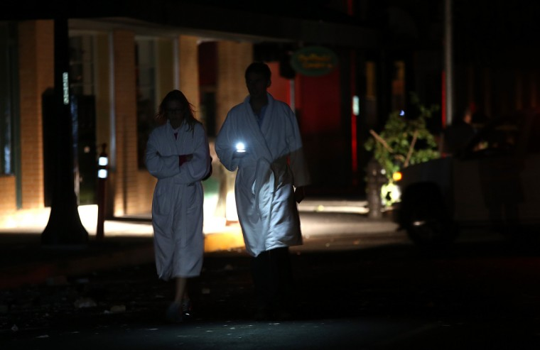 People wearing bathrobes walk down a street following a reported 6.0 earthquake on August 24, 2014 in Napa, California. A 6.0 earthquake rocked the San Francisco Bay Area shortly after 3 am on Sunday morning. (Justin Sullivan/Getty Images)