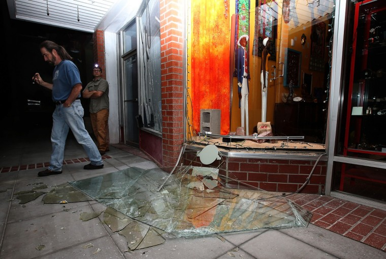 People survey a destroyed building following a reported 6.0 earthquake on August 24, 2014 in Napa, California. A 6.0 earthquake rocked the San Francisco Bay Area shortly after 3am on Sunday morning. (Justin Sullivan/Getty Images)