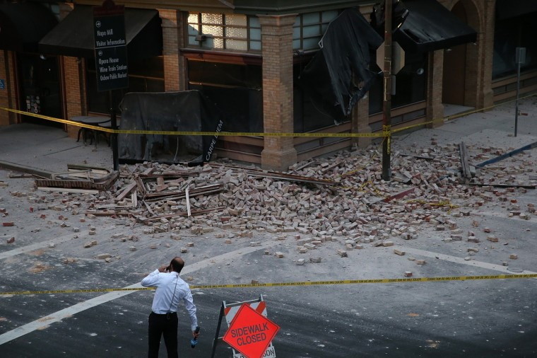 A reporter surveys the scene of a building collapse following a reported 6.0 earthquake on August 24, 2014 in Napa, California. A 6.0 earthquake rocked the San Francisco Bay Area shortly after 3:00 am on Sunday morning causing damage to buildings and sending at least 70 people to a hospital with non-life threatening injuries. (Justin Sullivan/Getty Images)