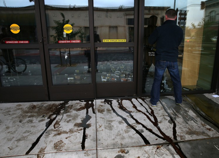 Vinegar flows out of the front door of a business damaged by a reported 6.0 earthquake on August 24, 2014 in Napa, California. A 6.0 earthquake rocked the San Francisco Bay Area shortly after 3:00 am on Sunday morning causing damage to buildings and sending at least 70 people to a hospital with non-life threatening injuries. (Justin Sullivan/Getty Images)