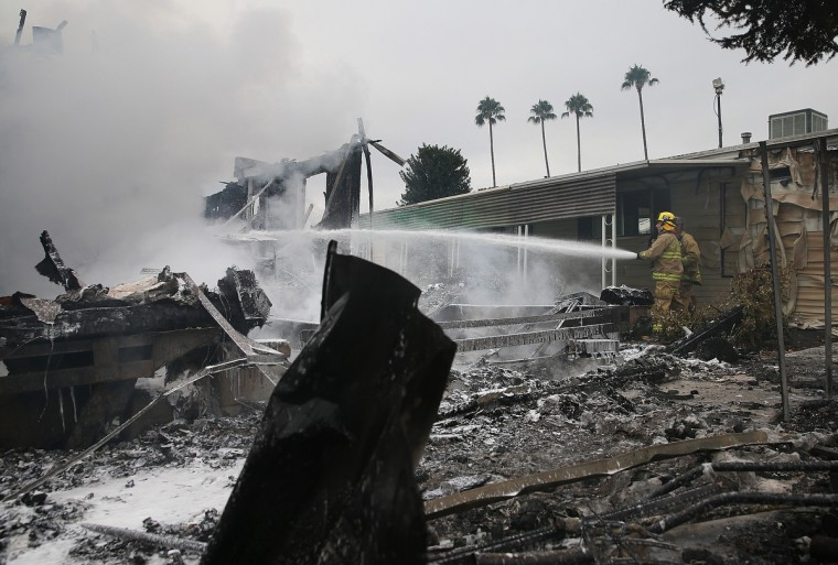 Napa County firefighters spray foam on hot spots from a fire at a mobile home park following a reported 6.0 earthquake on August 24, 2014 in Napa, California. A 6.0 earthquake rocked the San Francisco Bay Area shortly after 3:00 am on Sunday morning causing damage to buildings and sending at least 70 people to a hospital with non-life threatening injuries. (Justin Sullivan/Getty Images)