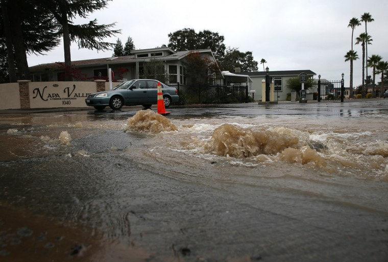 Water gushes from the ground from a water main break oustide of a mobile home park following a reported 6.0 earthquake on August 24, 2014 in Napa, California. A 6.0 earthquake rocked the San Francisco Bay Area shortly after 3:00 am on Sunday morning causing damage to buildings and sending at least 70 people to a hospital with non-life threatening injuries. (Justin Sullivan/Getty Images)