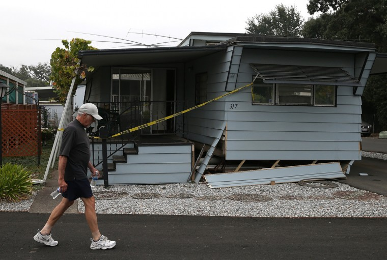 A pedestrian walks by a mobile home that shifted off of its foundation at a mobile home park following a reported 6.0 earthquake on August 24, 2014 in Napa, California. A 6.0 earthquake rocked the San Francisco Bay Area shortly after 3:00 am on Sunday morning causing damage to buildings and sending at least 70 people to a hospital with non-life threatening injuries. (Justin Sullivan/Getty Images)