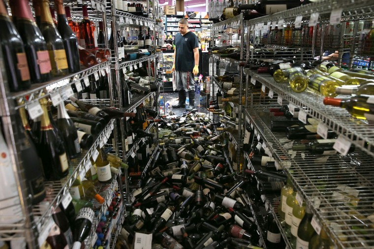 A worker looks at a pile of wine bottles that were thrown from the shelves at Van's Liquors following a reported 6.0 earthquake on August 24, 2014 in Napa, California. A 6.0 earthquake rocked the San Francisco Bay Area shortly after 3:00 am on Sunday morning causing damage to buildings and sending at least 70 people to a hospital with non-life threatening injuries. (Justin Sullivan/Getty Images)
