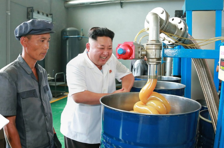 This undated picture released from North Korea's official Korean Central News Agency (KCNA) shows North Korean leader Kim Jong-Un (C) inspecting the Chonji Lubricant Factory at an unconfirmed location. (Getty Images)
