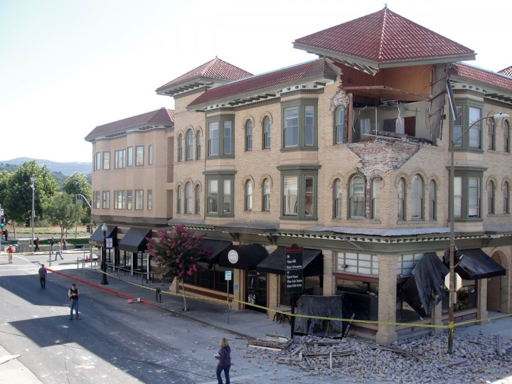 Damage is seen to the Facade of a building housing the Carpe Diem restaurant in downtown Napa, California on August 24, 2014. California's governor declared a state of emergency Sunday following a strong 6.0-magnitude earthquake that seriously injured three people including a child and ignited fires in the scenic Napa valley wine region. The US Geological Service said that the quake was the most powerful to hit the San Francisco Bay area since the 1989 6.9-magnitude Loma Prieta earthquake. (Glen Chapman/Getty Images)