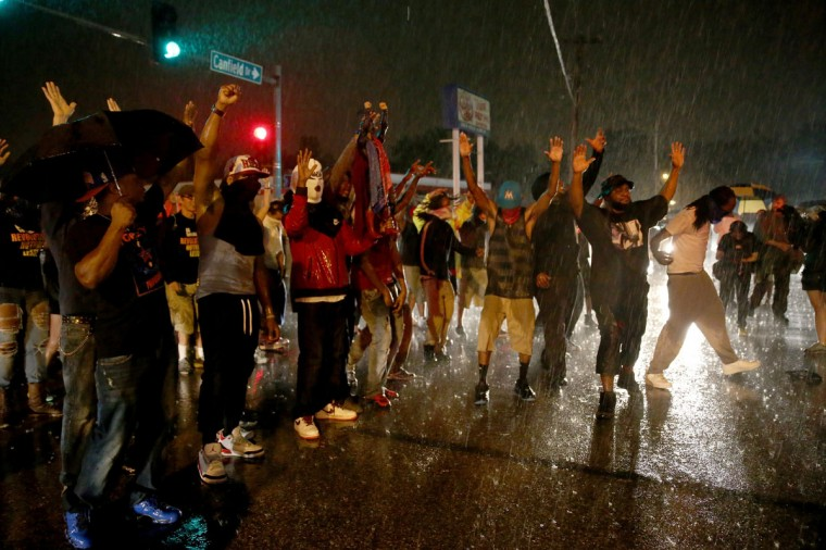 Demonstrators protesting the shooting death of Michael Brown raise their arms with some chanting, ' Hands up, Don't Shoot', on August 16, 2014 in Ferguson, Missouri. Violent outbreaks have taken place in Ferguson since the shooting death of Michael Brown by a Ferguson police officer on August 9th. (Joe Raedle/Getty Images)