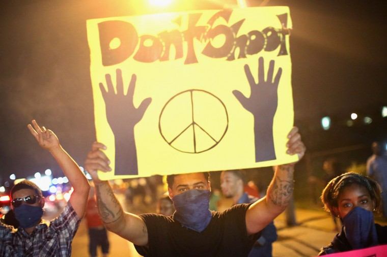 Demonstrators hold up a 'don't shoot' sign during a protest at the killing of teenager Michael Brown on August 17, 2014 in Ferguson, Missouri. Despite the Brown family's continued call for peaceful demonstrations, violent protests have erupted nearly every night in Ferguson since his death. (Scott Olson/Getty Images)