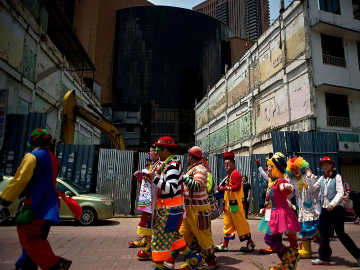Clowns take part in a parade during the Clown Festival in Kuala Lumpur on August 17, 2014. Around 80 clowns from all over Malaysia took part in the event organized by the Association of Clowns Malaysia to provide a platform for clown education, acquiring new skills and offering members support. (Manan Vatsyayana/AFP/Getty Images)
